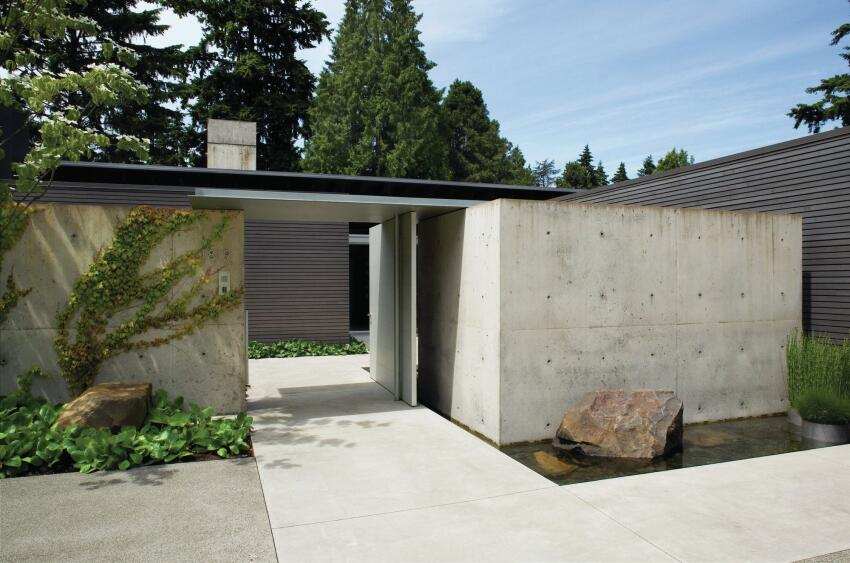 Concrete landscape walls conceal the expansive glazed walls, and exposed timbers and wood decking of Suyama's design for the Broadmoor residence, which was completed in 2005.