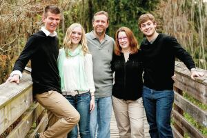Seeking citizenship: Steve and Zoe Adams are among the thousands of foreigners living in the United States with E-2 Treaty Investor Visas. The couple owns Richards Pool Service in Florida. Pictured above is their son Tom (far right), Zoe, Steve, daughter Melissa and her husband, Jordan, (far left).