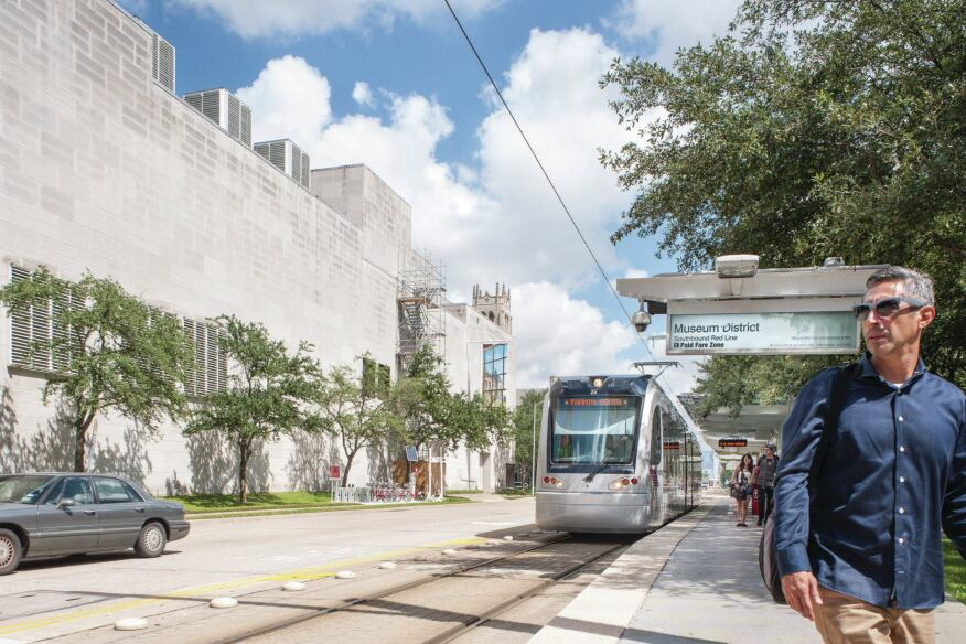 The city's light-rail system (here running by the Museum of Fine Arts, Houston) transports about 38,000 riders a day.