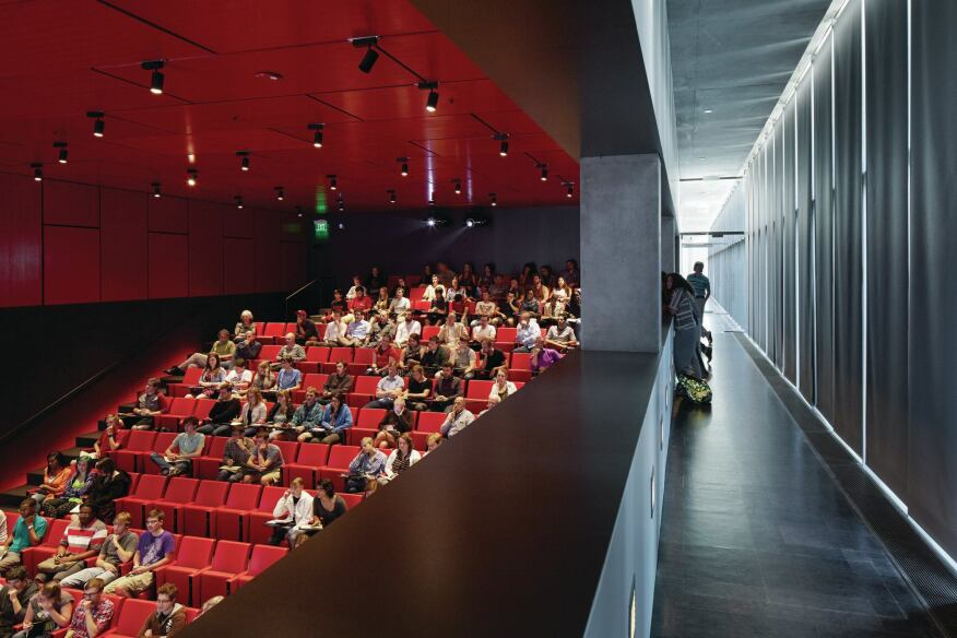 In the 200-seat auditorium, the lighting is set on separately controlled layers to meet the needs of the space. The LED ceiling downlights are dimmable and shades along the corridor window wall can be drawn for projection presentations and films.