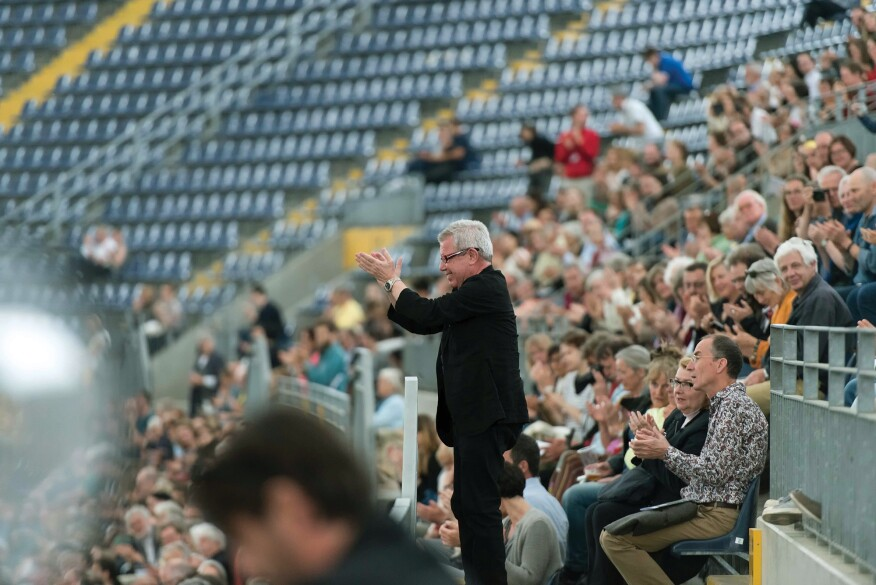 Daniel Libeskind applauds a violinist at Commerzbank Arena in Frankfurt, Germany