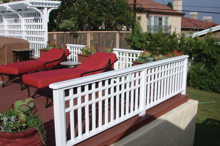 This railing was built with redwood and has a paint finish, though the same design could be built with reinforced composite balusters.