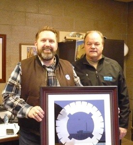 Senator John Pederson, Senate District 14 in Central Minnesota, receives the Government Official of the Year Award from IGGA member Terry Kraemer of Diamond Surface, Inc.