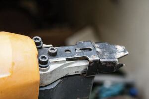 The Bostitch mechanism requires the use of an Allen wrench.