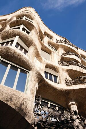 """Casa Milà/La Pedrera • Location: Barcelona, Spain • Developer: Pere Milà i Camps • Architect: Antoni Gaudi • Notable: Containing not one straight wall or right angle, La Pedrera (""""The Quarry"""") seems to have been molded rather than built, both inside and out. The building, constructed from 1906 to 1912, was the first in Europe to include an underground parking garage. It is now a museum."""