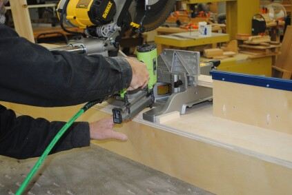 Bolts and wing nuts replace the screws at a later time. Nail blocks around the saw feet to ensure perfect placement in the stand each time the saw is set up.