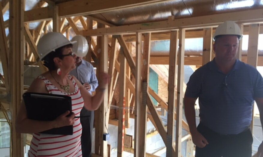 "Architect Deryl Patterson and Taylor Morrison regional vp of construction Steve Atwood look for opportunity areas in what Patterson refers to as the ""Florida basement"" during the NEXTadventure Home frame walk at Esplanade, Highland Ranch, Clermont, Fla."