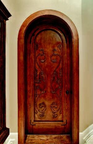 INTERIOR DEPARTMENT: Handcrafted doors aren't only for the entry, which is why the design team selected  carved interior openings from Old World Door. The door to the master  suite, for example, is made from solid 1 ¾-inch-thick alder and has  no engineered composites or veneers. Mortise-and-tenon construction comes  standard. It features a Tuscany distress fruit-wood stain.