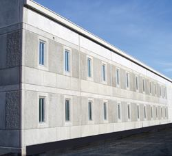 Modular precast jail cells minimized energy consumption, materials, and waste at Coyote Ridge Corrections Center, the country's first LEED Gold prison.