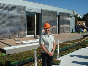 Andrew McCoy, associate professor at Virginia Tech, stands in front of the school's entry into the 2009 Solar Decathlon. The 800-square-foot home lives large thanks to sliding glass walls that open up the space.