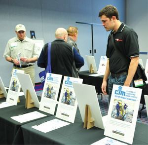 Attendees review silent auction items at the Concrete Industry Management Auction.