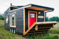 Eco-Friendly Tiny House Offers Reclaimed Style and Drawbridge Deck