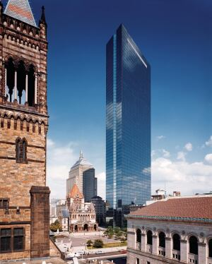 Cobb minimized the Hancock's perceived volume in part by introducing notches that bisect the end walls, highlighting the building's rhomboid shape. The trapezoidal base captures reflections of Trinity Church.