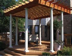 Creative Outdoor Wood Products included a retractable shade system and white fiberglass columns for a distinctive look, above.