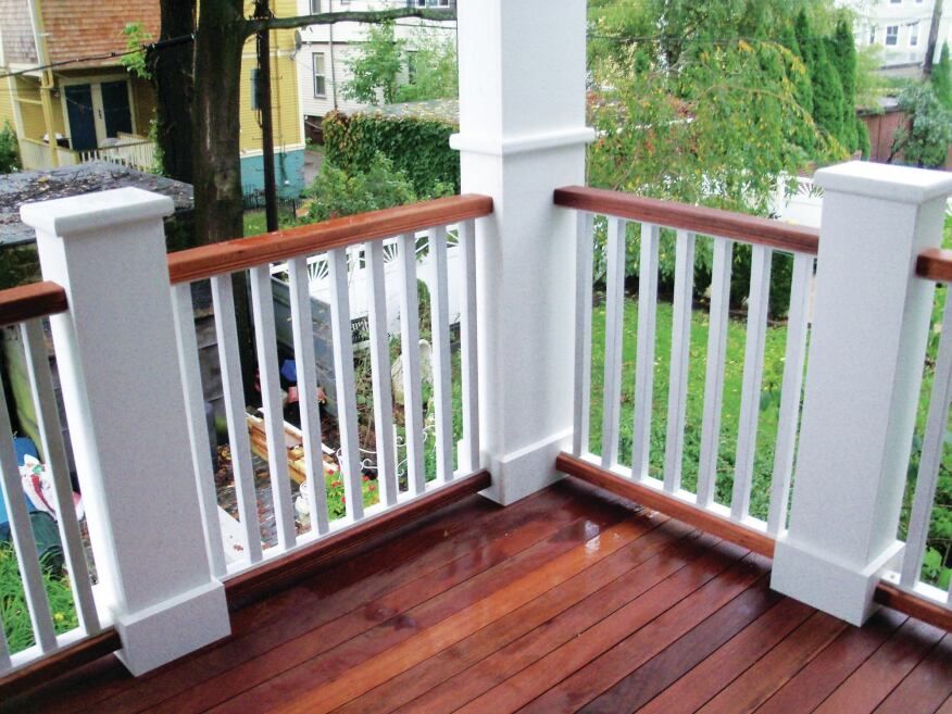 In this railing design, the upper and lower rails were milled to match the mahogany decking. The balusters are painted fir, and attached with screws and nails to PVC subrails.