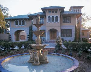 The addition of a porte cochere -- a roofed entrance over the driveway -- jazzed up the front facade of this Mediterranean Revival home without altering its essential appearance.