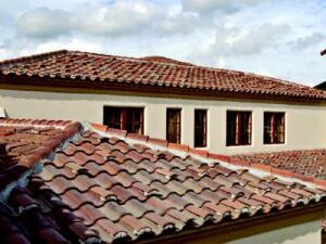 PROPER TOPPER: The InSync Home is topped by concrete roof tile manufactured by MonierLifetile. Weather  resistant and strong, the tiles are made from a combination of  sand, cement, water, and pigments for color. The tiles can contribute to savings  in the cost of energy used in the home, the maker says. MonierLifetile.