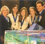 "The team from St. Thomas More School, Baton Rouge, La., won the national 2005 Future City Competition. Left to right: Shirley Newman, teacher; students Lauren Arikol, Kathleen O'Hara, and Lisa Lynch; and engineer-mentor Jacques ""Jack"" Lasseigne. Photo: National Engineers Week"