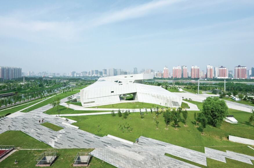 The building's faceted form is sited in a larger complex of five cultural buildings in Taiyuan, a city of 4 million located 325 miles southwest of Beijing.
