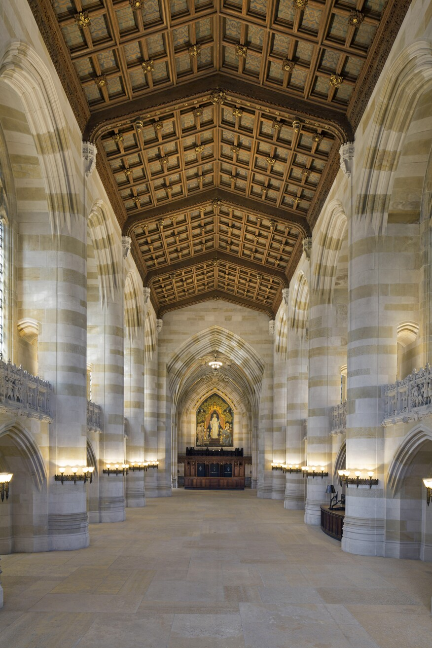 A view of the nave looking toward the mural Alma Mater.