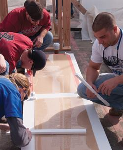 CIM students work on the stencil which includes the names of the honored firefighters.