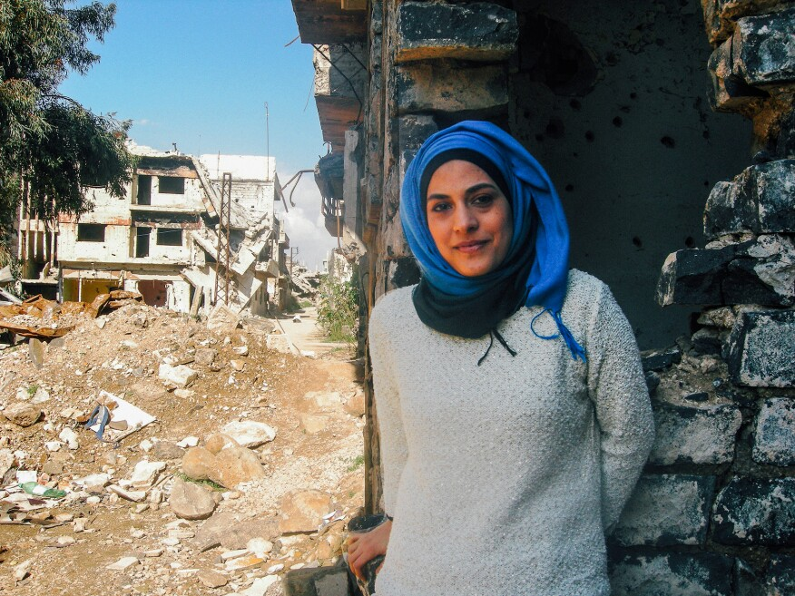 Architect and author Marwa al-Sabouni in her hometown of Homs, Syria. Once considered the capital of the revolution, Homs fell to government forces in late 2015. Much of the city lies in ruins.