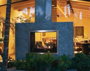 15 May 2006 --- Fireplace between Contemporary House and Patio --- Image by © Royalty-Free/Corbis