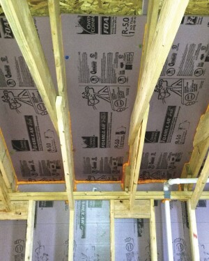 For a slight boost in R-value and to create a vent space that won't be crushed by the pressure of dense-blown cellulose, the author's company installs a custom insulation baffle in cathedral-roof rafter bays and scissors-truss bays.