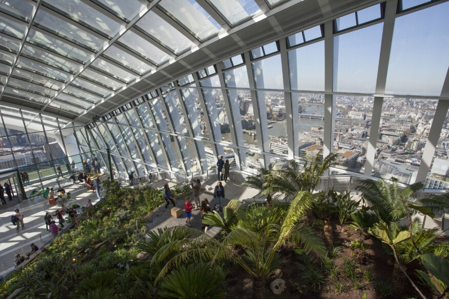 """The Sky Garden inside the """"Walkie Talkie"""" building (20 Fenchurch Street), designed byRafael Viñoly, AIA, is oneof London's newest free attractions. The 35th floor observations decks, gardens, and restaurant provides stunning views of the River Thames and new vistas of landmarks such as the Shard and St Paul's Cathedral."""