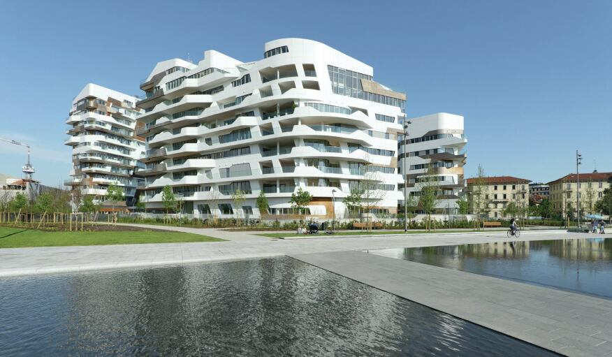 The residential complex designed by Zaha Hadid Architects is more curvaceous in form than Libeskind's, with wood inlays set around the concrete structure.