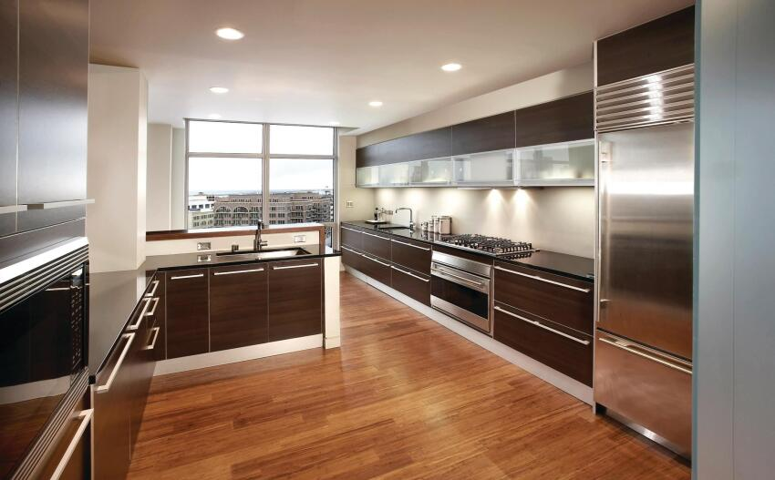 Cabinetry laid out in long, horizontal bands directs attention toward views of downtown Milwaukee and Lake Michigan.