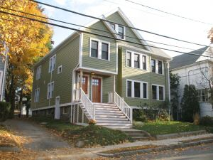 The Arlington, Mass., duplex strikes a pose with new siding, windows, and doors, but underneath the building's new foam insulation, exterior foam board, heat recovery ventilator,andtankless waterheater help save the homeowners up to 68% in fuel oil cost per year.