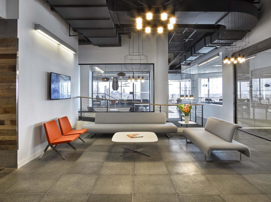 Soft seating in the reception area is by Teknion.