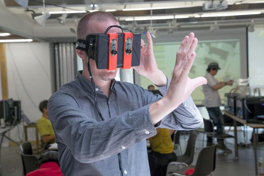 Smartgeometry director Shane Burger wears a modified Oculus Rift to immerse himself visually within a 3D augmented reality.