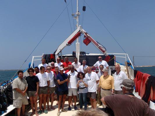 Goddio's team pose prior to another underwater excavation.