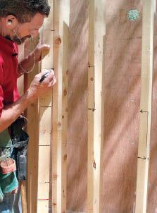 Figure 9. Use a story pole with the tread elevations marked on it to lay out the risers and treads on the frame.
