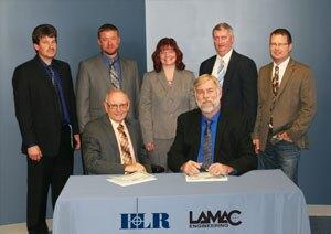 Pictured, standing, left to right: Aaron Mefford professional engineer, Lamac; Jacob Lewis, professional land surveyor, Lamac; Jeni Lyon, executive vice president, HLR; John Acree, vice-president, Lamac; and Austin Ridgely, vice-president, Lamac. Front row: Michael Gill, regional manager, Lamac (left); and David Hinkston, President/CEO, HLR (right).