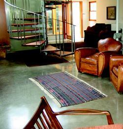 This integral green-gray polished floor had several grinds from 40 to 150 grit. It was completed with an application of a wet-look lacquer and a high solids floor finish.