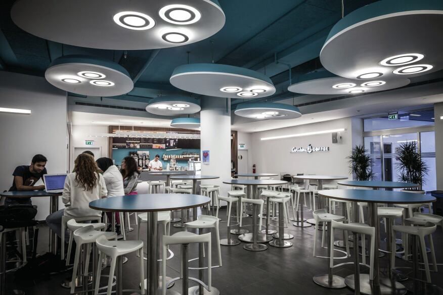 "In the cafe, signature lighting elements, what lighting designer Cherine Saroufim Sacy calls ""the eggs,"" house 40W 4000K T5 Circuline lamps."