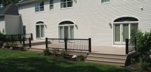 The old wood railing was replaced with TimberTech's RadianceRail composite deck rail.