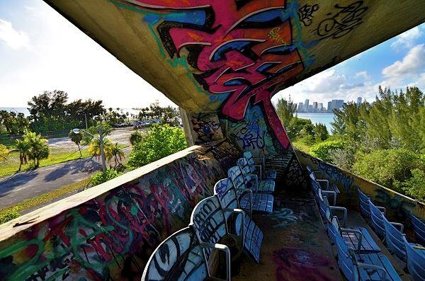 A corner of the stadium as it looks today, with views of Miami in the distance. The colorful graffiti has made it a magnet for underground fashion shoots and even quinceañera portraits—all staged illicitly.