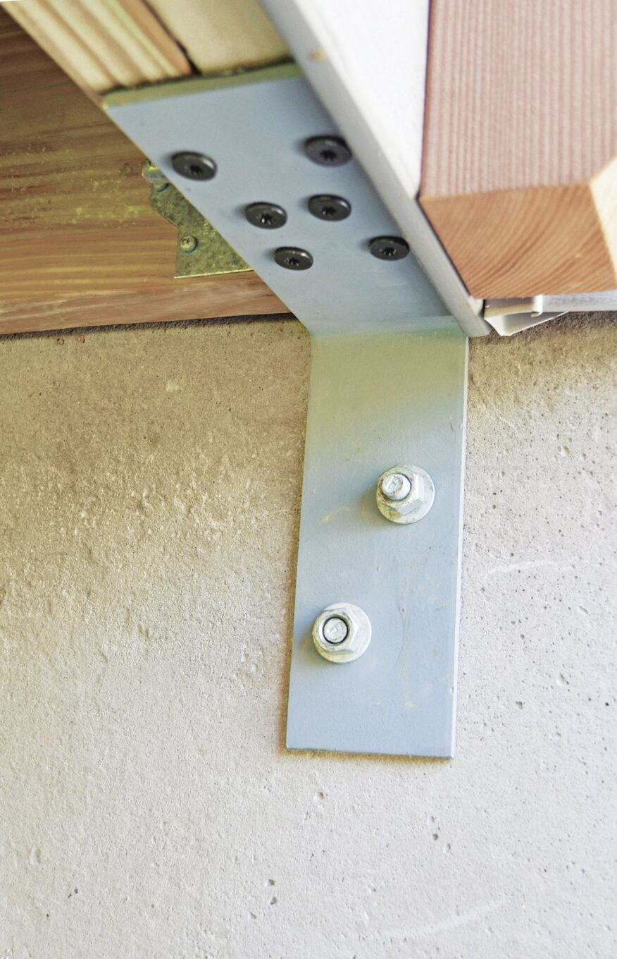 The author designed a second custom L-bracket for use without a 2-by brace. It's fabricated from 1/4-inch-thick steel plate, with each leg measuring 3 inches by 9 inches. The brackets are hot-dipped galvanized for corrosion protection, and when installed, are isolated from treated framing with self-adhering flashing.