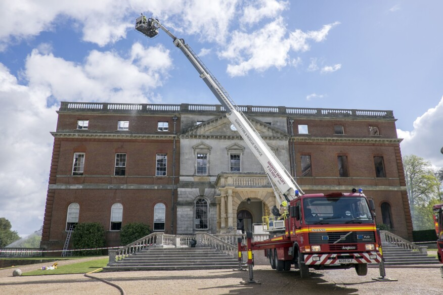 Fire officers at the Clandon Park House, in Guildford, Britain. Designed by the Venetian architect Giacomo Leoni, the 18th-century Palladian mansion was gutted by a huge fire on Wednesday afternoon.