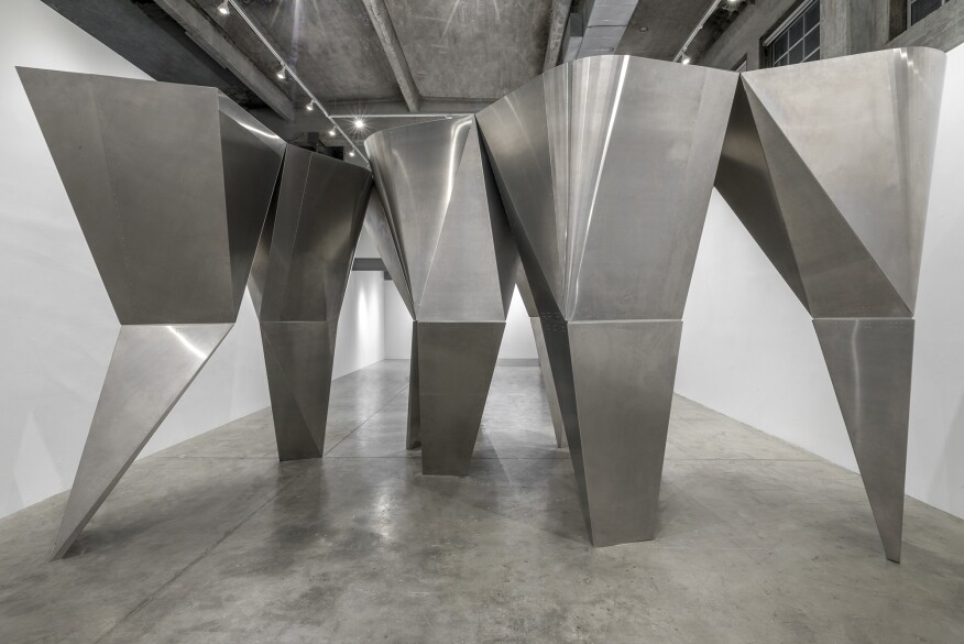 """The """"En Pointe"""" installation at the SCI-Arc Gallery features top-heavy, faceted columns that lean on each other for support and create a cohesive massing."""