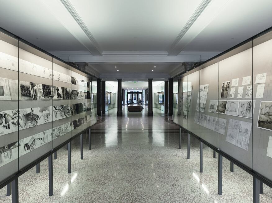 The corridor that runs from the east entrance is lit by a series of vitrines that are used to display student work. The vitrines are illuminated with 32W T8 fluorescent fixtures. The interior of the cases house asymmetric LED wallwashers at 9W-per-linear-foot.
