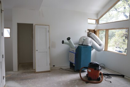 Curing drywall mud and slab foundations can also pump moisture into an enclosed interior. Risinger reduces this moisture by using industrial dehumidifiers.