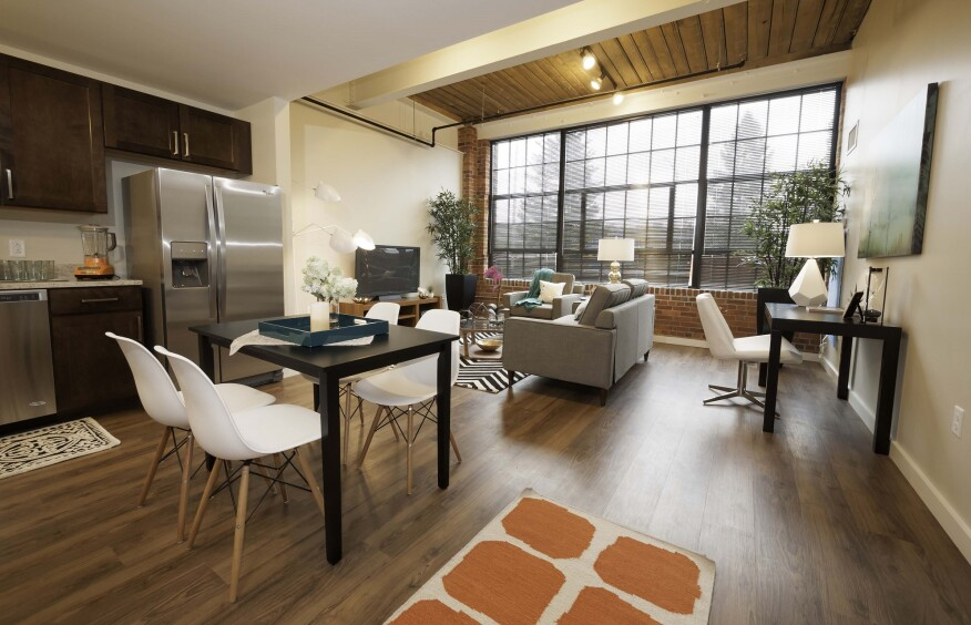 Synthetic wood flooring replaces the original floorboards at Voke Lofts. The sustainably made product contains mostly recycled material.