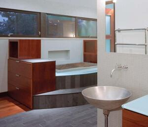 """great white hope  You won't hear many architects liken sand-cast basins to """"finely crafted musical instruments."""" But Clark likes Bruce Tomb's sinks so much that he has even installed one in his own home. He's also speced them for several firm projects, including the one seen here. Clark's look of choice is white bronze, but the artist also works with silicon bronze, brass, and aluminum. The rough casting grain is left alone on the outer circle, while the inside is satin-polished. Infinite Fitting, 415.970.9210; www.infinitefitting.com.  """"sexy and free-floating."""""""