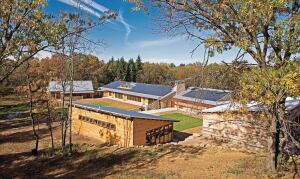 Energy use was a specific focus for the center, which was designed to produce more than 110 percent of its annual energy needs. Program spaces are purposefully disconnected from the main building to reduce energy loads.