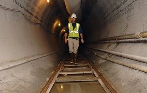 A geologist walks through a 1.5 mile tunnel that connects to a series of five collector wells to reach cleaner source water. The project went online in September. Photo: Louisville Water Co.
